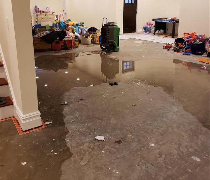 Heavy rain storm and finished basement flooded after sump pump failed